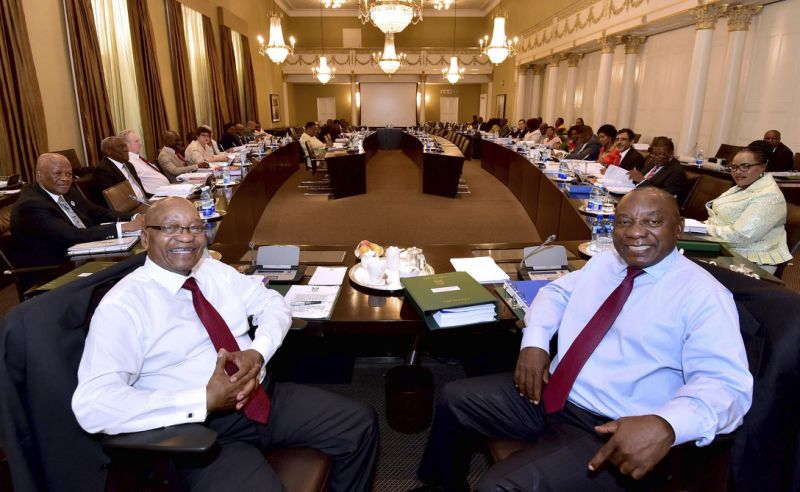 In this photo supplied by the South African Government Communications and Information Services (GCIS) South African President Jacob Zuma, left, and Deputy President Cyril Ramaphosa, right, with minsters and deputy ministers at a scheduled routine meeting of Cabinet Committees at parliament in Cape Town, South Africa, Wednesday, Feb. 7, 2018. The speaker of parliament said Tuesday that Zuma will not give the state of the nation address in parliament that had been set for Thursday and the ruling African National Congress party announced the postponement of a meeting Wednesday to discuss the president's fate. (South African Government Communication and Information Services / Elmond Jiyane /via AP)