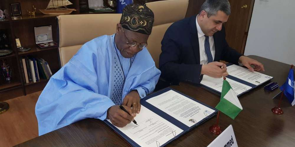 Minister of Information and Culture, Alhaji Lai Mohammed, and the UNWTO's Secretary-General, Mr. Zurab Pololikashvili, signing the Agreement on Nigeria's hosting of the 61st CAF Meeting, in Madrid, Spain, on Friday