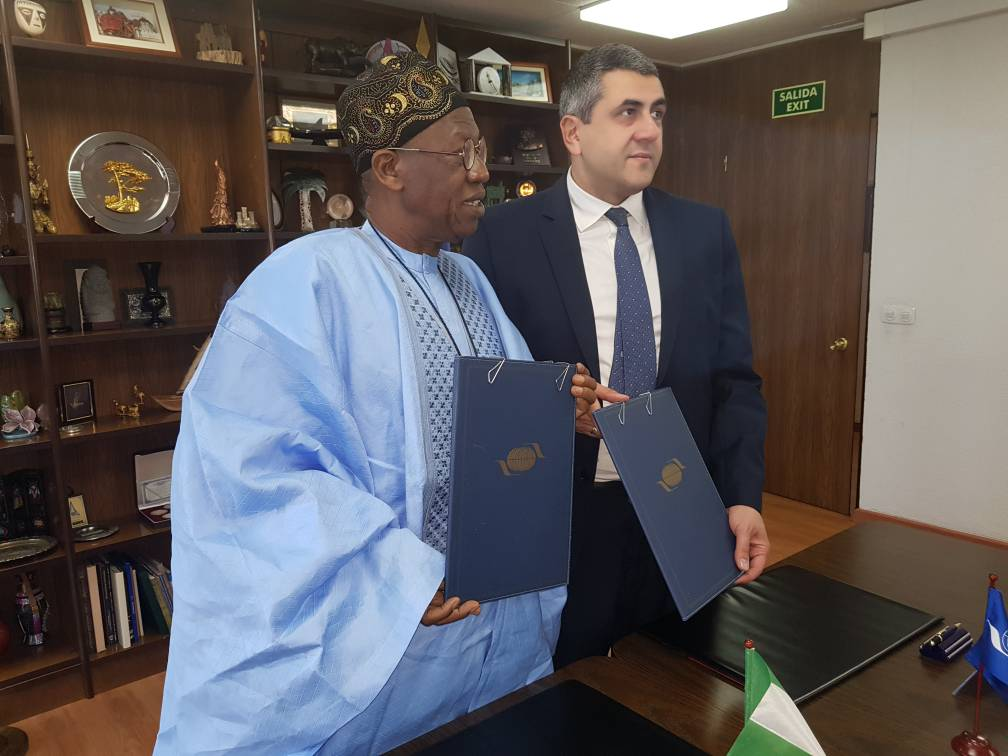 Minister of Information and Culture, Alhaji Lai Mohammed, displaying copies of the signed Agreement on Nigeria's hosting of the 61st CAF Meeting, in Madrid, Spain, on Friday.