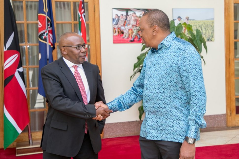 Kenya's President Uhuru Kenyatta (R) meets Attorney General Githu Muigai after Muigai handed in his resignation letter at State House in Nairobi, Kenya February 13, 2018. Presidential Press Service/Handout via REUTERS Reuters
