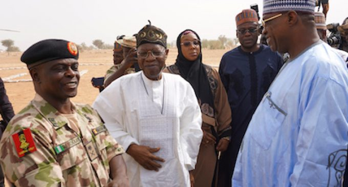 Yobe State Governor Ibrahim Gidan (R) speaks with Information Minister Lai Mohammed (C) and the head of the military force fighting Boko Haram, Brigadier General Rogers Nicholas, on the premises of the Government Girls Science and Technical College, in Dapchi, Nigeria, on February 22, 2018