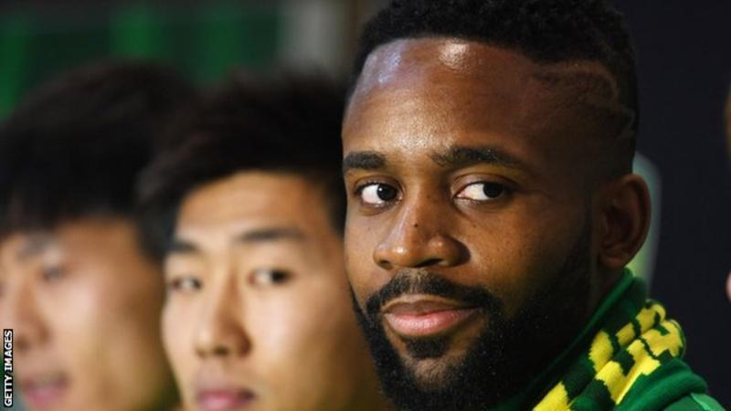 DR Congo international Cedric Bakambu at a press conference with his new Beijing Guoan team-mates in Beijing