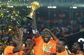 Yaya Toure raises the trophy at the end of the 2015 African Cup of Nations final