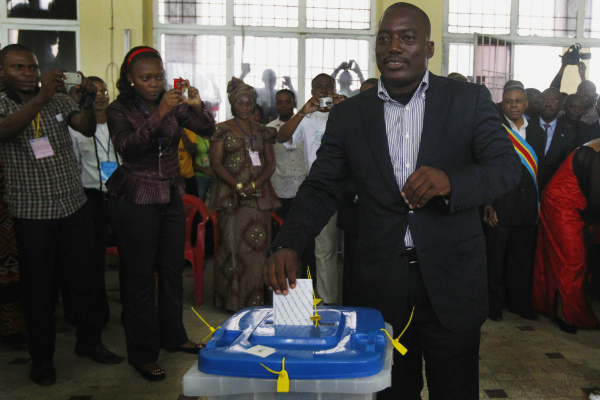 Congolese president Joseph Kabila casts his ballot in the country's presidential election at a polling station in Kinshasa, Democratic Republic of Congo on Nov. 28, 2011.