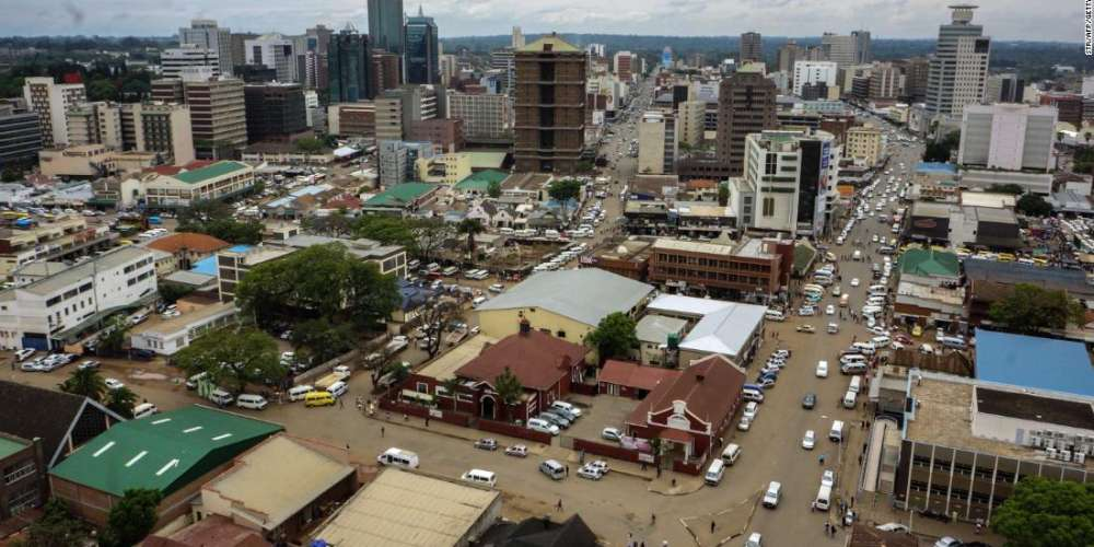 "A photo shows a view of the Zimbabwean capital Harare on November 16, 2017, a day after the military took power and announced plans to arrest ""criminals"" close to the president.  Zimbabweans weighed an uncertain future on November 16 without President Robert Mugabe after the army took power and placed the 93-year-old, a liberation hero turned authoritarian leader, under house arrest. / AFP PHOTO / STR        (Photo credit should read STR/AFP/Getty Images)"