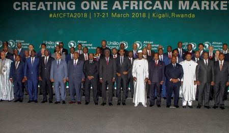African leaders pose for a group photograph as they meet to sign a free trade deal that would create a liberalized market for goods and services across the continent, in Kigali, Rwanda March 21, 2018. REUTERS/Jean Bizimana