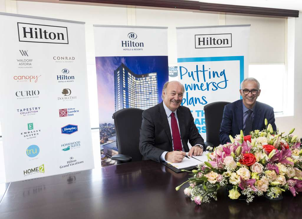 Rudi Jagersbacher, President, Middle East, Africa & Turkey, Hilton and Abderrahmane El Ouazzani signing the contracts