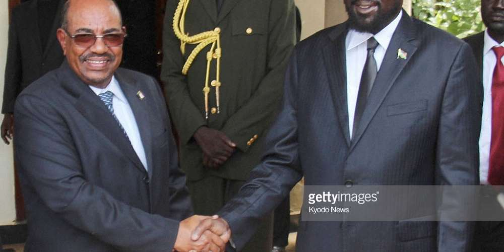 JUBA, South Sudan - File photo shows Sudanese President Omar al-Bashir (L) and South Sudanese President Salva Kiir shaking hands at Kiir's presidential office in Juba in April 2013. (Kyodo)