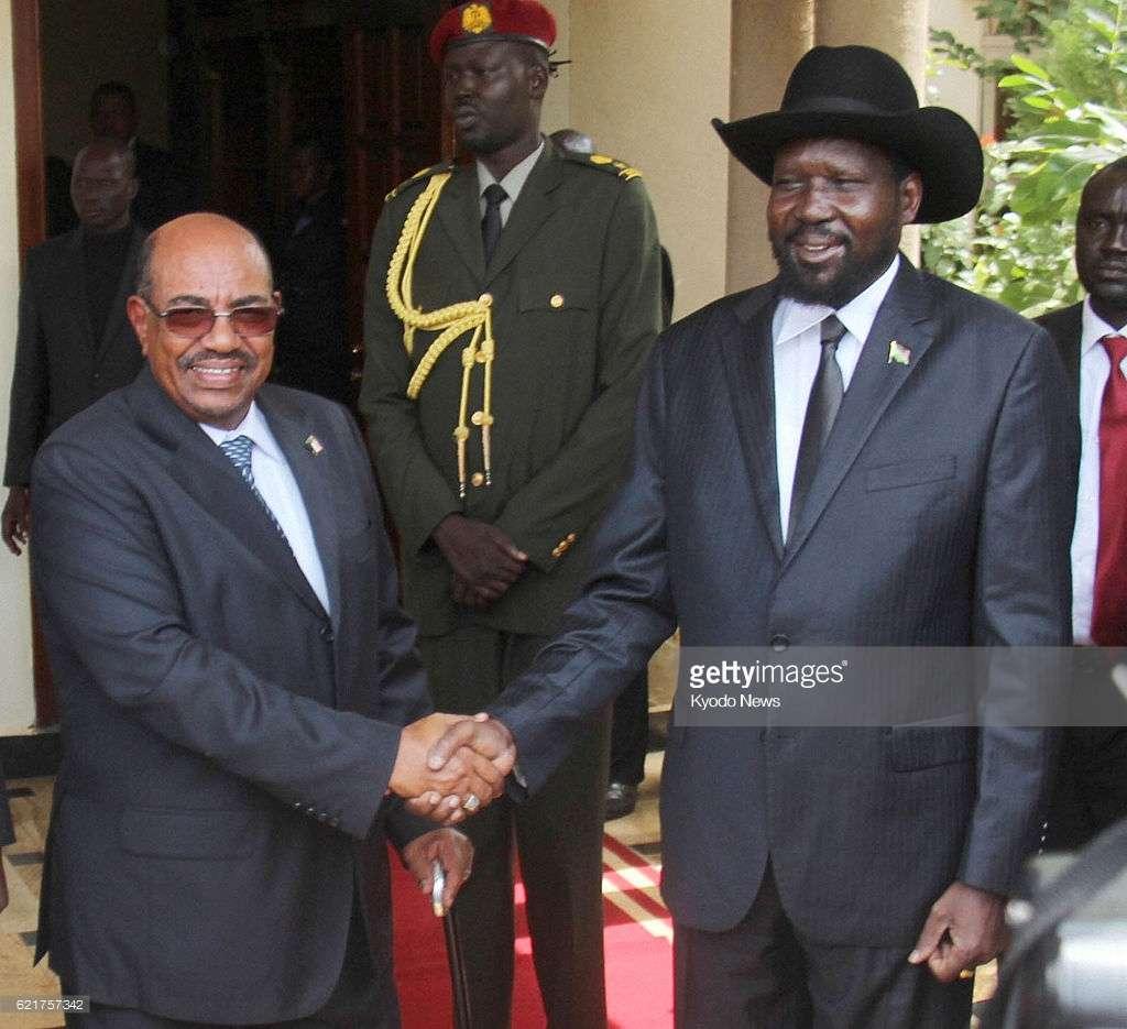 JUBA, South Sudan - File photo shows Sudanese President Omar al-Bashir (L) and South Sudanese President Salva Kiir shaking hands at Kiir's presidential office in Juba in April 2013. (Kyodo)