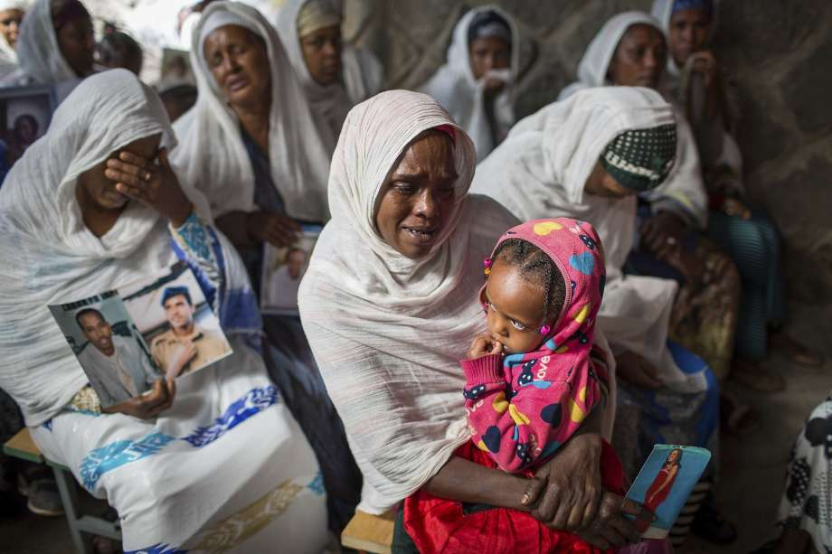 Photo: Mulugeta Ayene, Associated Press Members of Ethiopia's Jewish community hold pictures of their relatives in Israel in Addis Ababa.