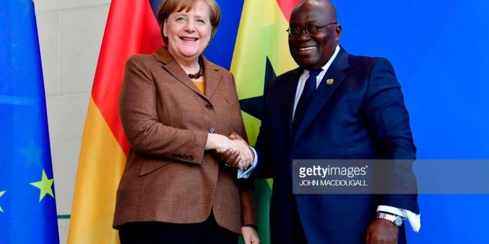 German Chancellor Angela Merkel shakes hands with Ghana's President Nana Akufo-Addo (R)