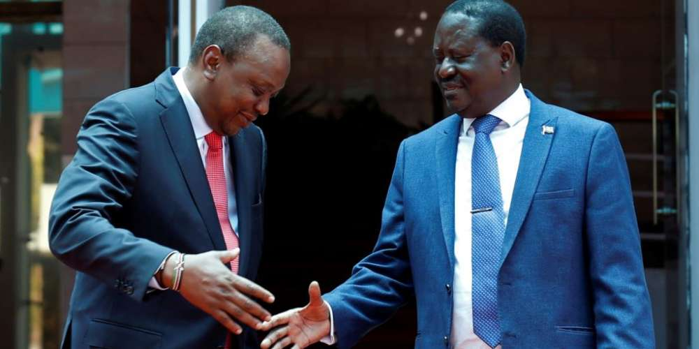 Kenya's President Uhuru Kenyatta, left, and opposition leader Raila Odinga of the National Super Alliance (NASA) coalition shake hands after a joint news conference in Nairobi, March 9, 2018.