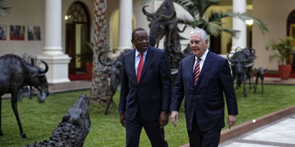 U.S. Secretary of State Rex Tillerson, right, walks with Kenya's President Uhuru Kenyatta, left, past metal sculptures of animals, inside State House in Nairobi, Kenya, March 9, 2018.