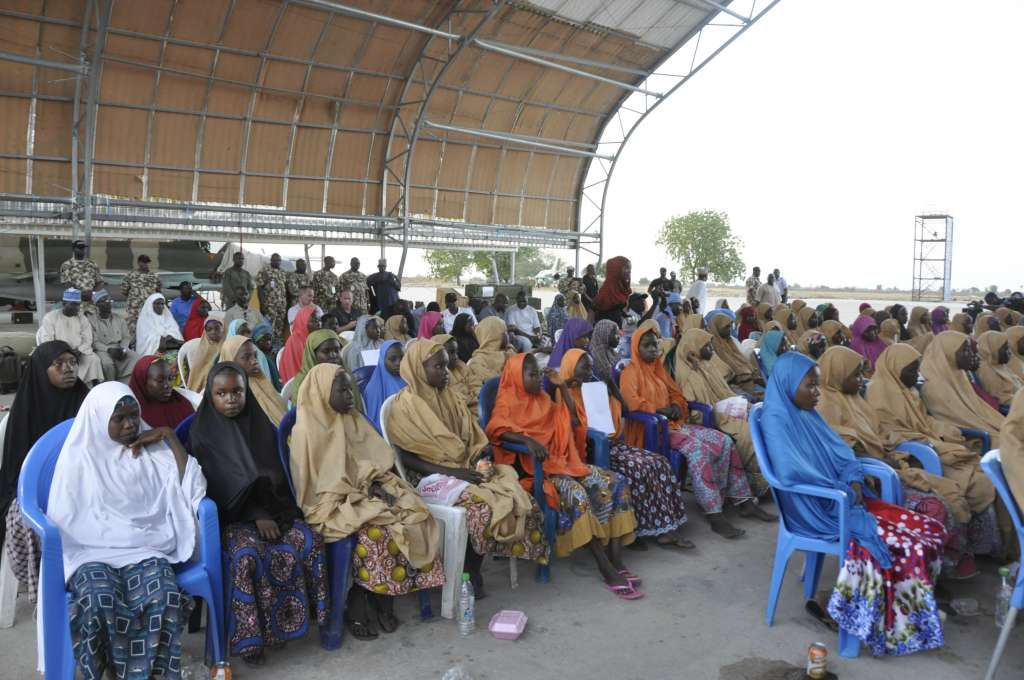 The freed 104 Dapchi girls, one other girl and a boy assembled at the Nigerian Air Force Base in Maiduguri...on Wednesday