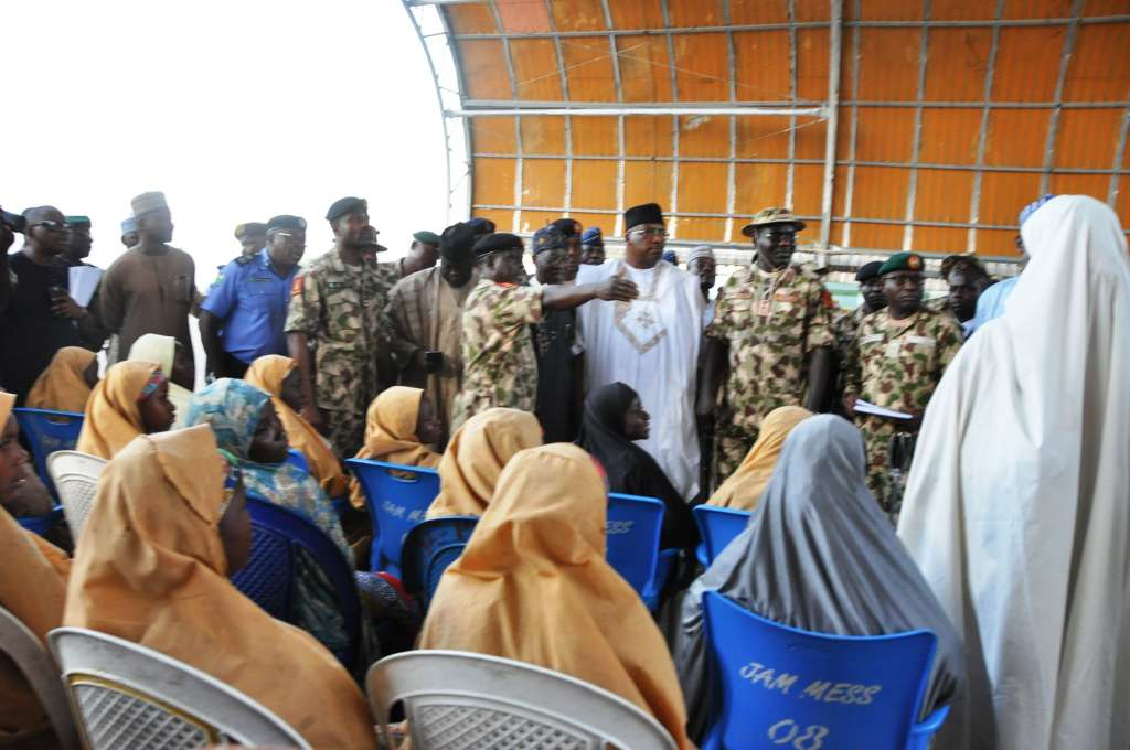 The Federal Government Delegation meets the freed 104 Dapchi girls, one other girl and a boy at the Nigerian Air Force Base in Maiguduri...on Wednesday.