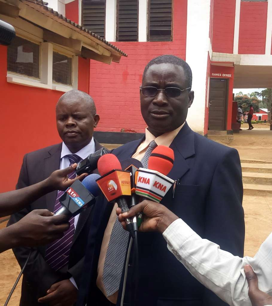 Kisii County Education board Chairman Dr Henry Onderi with County Director Education  Dr William Sugut have advised  opening up of many schools  leads to  poor  performance