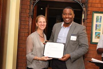 Munyutu Waigi, Co-Founder and Chief Customer Officer of Umati Capital receives the 2015 Zambezi Prize