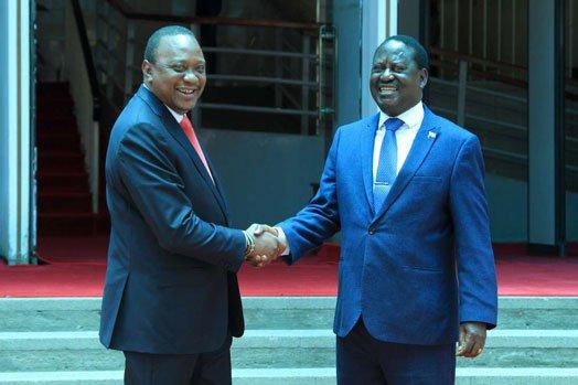 President Uhuru Kenyatta shakes hand with Raila Odinga when they met at Harambee House, Nairobi. PHOTO | JEFF ANGOTE