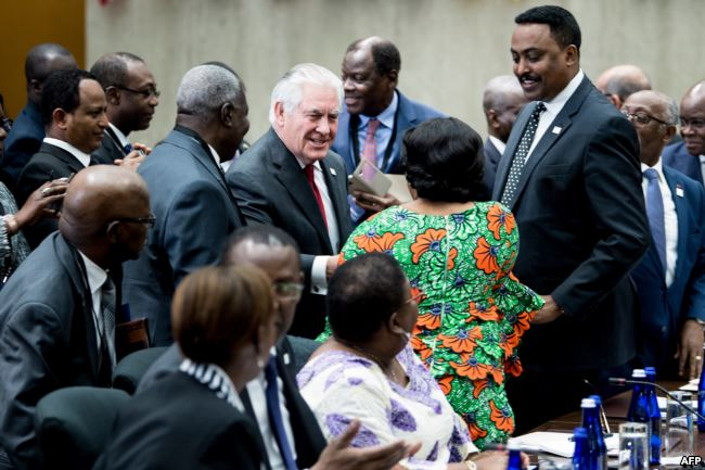 U.S. Secretary of State Rex Tillerson greets participants during a meeting of African leaders at the State Department in Washington