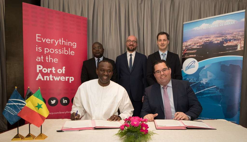 (Front) Dakar harbour general manager Aboubacar Sedikh Beye and Antwerp international harbour director, Kristof Waterschoot, (Back) Ministre de la pêche et de l'économie maritine Oumar Gueye, Belgian Prime Minister Charles Michel and Vice-Prime Minister and Minister of Cooperation Development, Digital Agenda, Telecom and Postal services Alexander De Croo pictured during the signature of a protocol agreement between Dakar and Antwerp ports at the Terrou-Bi hotel in Dakar, Senegal, on the third and last day of a visit to Senegal, Friday 02 March 2018. BELGA PHOTO BENOIT DOPPAGNE