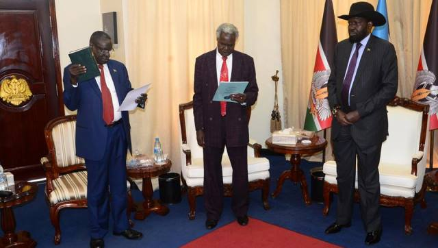 President Kiir witnesses Salvatore [left] take oath of office at State House on Tuesday, Mar 13, 2018 | Photo | Presidential Unit
