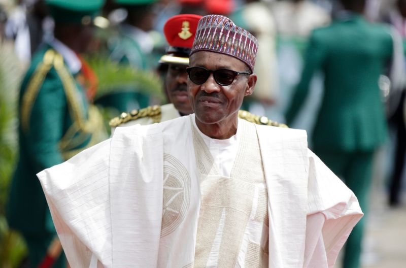 FILE - In this Friday, May 29, 2015 file photo, Nigerian President Muhammadu Buhari arrives for his Inauguration at the eagle square in Abuja, Nigeria. After more than a year in office, President Donald Trump for the first time is hosting an African president at the White House. The meeting with Nigerian President Muhammadu Buhari on Monday, April 30, 2018 comes after an uncomfortable start to the Trump administration's approach to the world's second most populous continent. (AP Photo/Sunday Alamba, File)