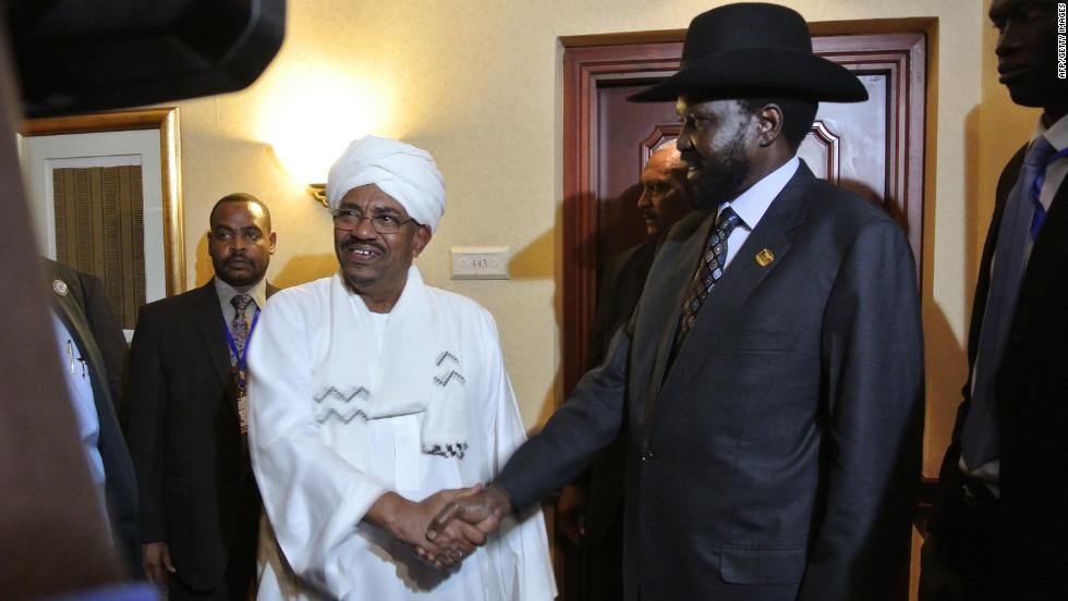 Sudanese President Omar Al Bashir, left, shakes hands with South Sudanese President Salva Kiir