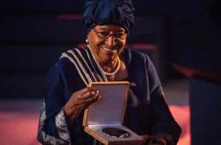 Former President of Liberia Ellen Johnson Sirleaf reacts with the medal after receiving the Ibrahim Prize, the world's biggest individual prize for Achievement in African Leadership, during 2018 Ibrahim Governance Weekend at Kigali Convention Centre in Kigali, Rwanda late April 27, 2018. She is the first woman who receives the award as 5th laureate since 2007. The prize only goes to a democratically-elected African leader who demonstrated exceptional leadership, served their mandated term and left office within the last three years. The award comes with $5 million (4.7 million euros) paid over 10 years and $200,000 annually for life from then on. / AFP PHOTO / Cyril NDEGEYACYRIL NDEGEYA/AFP/Getty Images