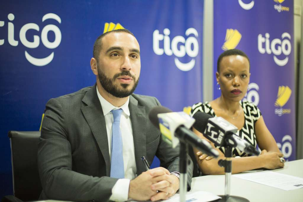 Tigo Tanzania's Chief Officer for Mobile Financial Services, Hussein Sayed (left), briefs journalists on the GSMA Mobile Money Certification that Tigo Pesa mobile money service has received at the GSMA-Mobile 360 World Congress held in Abidjan Cote d'Ivoire, West Africa, yesterday, making Tigo Pesa one of the first mobile money services in the world to receive the prestigious certification . Flanking him is Tigo's Corporate Communications Manager, Woinde Shisael (right)