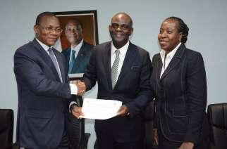 From left: Minister for Communication, Digital Economy and Postal Services, Cote D'Ivoire, Minister Bruno Koné; Member, Board of Directors, MainOne, Dapo Oshinusi and Chief Executive Officer, MainOne, Funke Opeke receiving the license to expand national and international connectivity services in Cote D'Ivoire last week