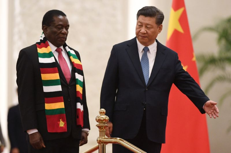 Zimbabwe's President Emmerson Mnangagwa (L) stands with Chinese President Xi Jinping during a welcoming ceremony at the Great Hall of the People in Beijing on April 3, 2018 Zimbabwe's President Emmerson Mnangagwa (L) stands with Chinese President Xi Jinping during a welcoming ceremony at the Great Hall of the People in Beijing on April 3, 2018 (AFP Photo/Greg BAKER)