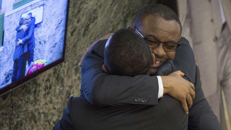 The outgoing prime minister, Haileamariam Dessalegn, right, who resigned from his post hugs to Abiy Ahmed, left, Monday, April 2, 2018. Ethiopia's legislature has elected young and outspoken Abiy Amhed as prime minister, amid hopes that he will be able to quell sustained anti-government protests in Africa's second most populous nation. (AP photo/Mulugeta Ayene) The outgoing prime minister, Haileamariam Dessalegn, right, who resigned from his post hugs to Abiy Ahmed, left, Monday, April 2, 2018. Ethiopia's legislature has elected young and outspoken Abiy Amhed as prime minister, amid hopes that he will be able to quell sustained anti-government protests in Africa's second most populous nation. (AP photo/Mulugeta Ayene)
