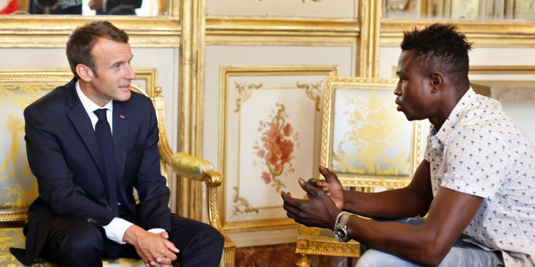 French President Emmanuel Macron meets 22-year-old Mamoudou Gassama, the real life Spiderman.