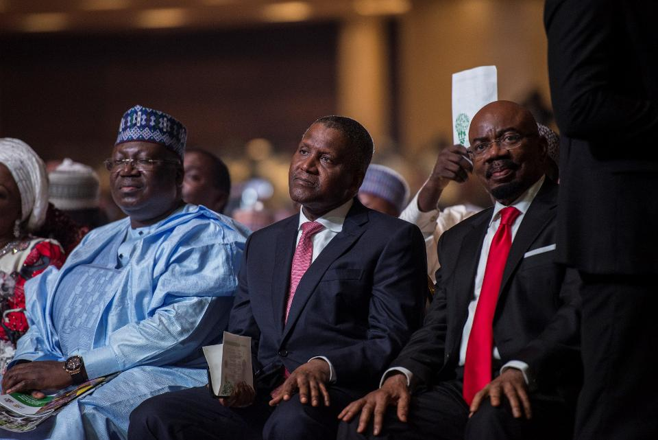 Nigerian businessman Aliko Dangote (C) listens to a speech as he attends the rally organized to celebrate the 66th birthday of the leader of the All Progressive Congress (APC) Asiwaju Bola Tinubu, in Lagos, on March 29, 2018. Photo credit should read STEFAN HEUNIS/AFP/Getty Images)