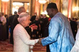 Queen Elizabeth II greets Adama Barrow, Gambia's President, in the Blue Drawing Room. He wore the right color for the occasion. (Photo by Victoria Jones - WPA Pool/Getty Images)