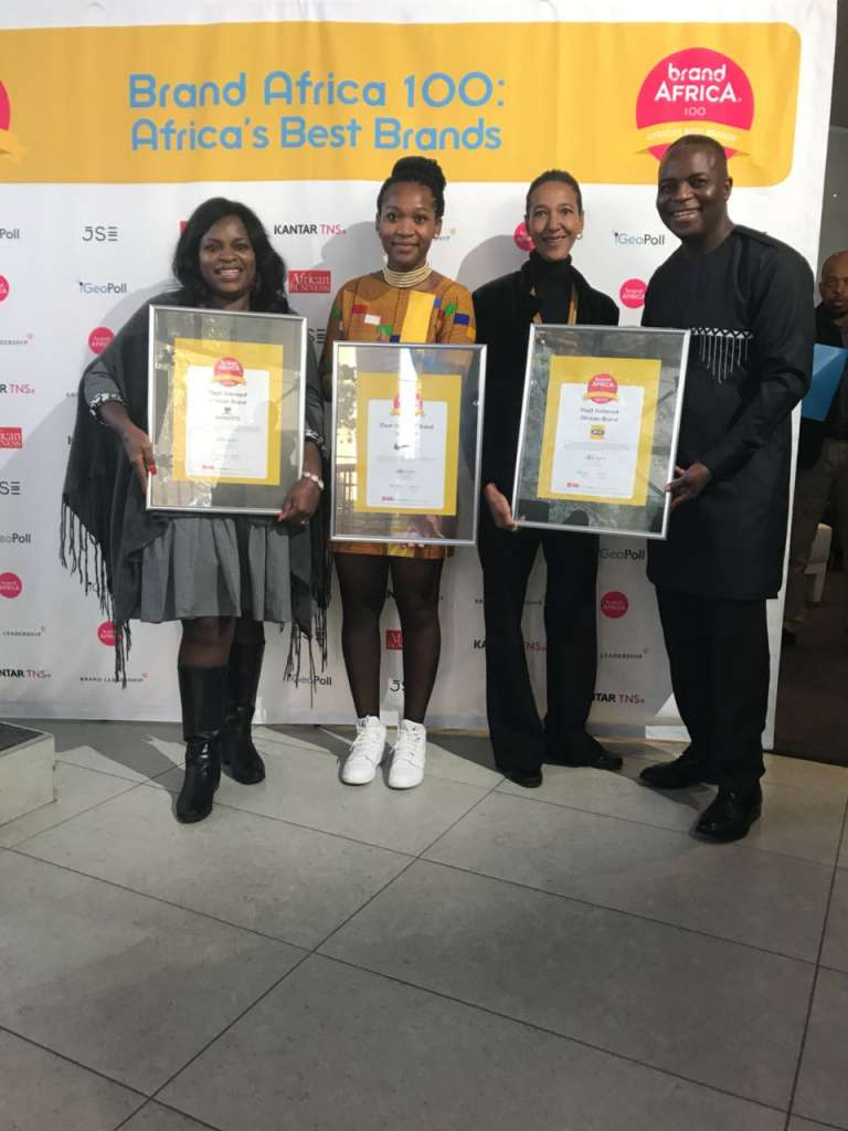 Thebe Ikalafeng Founder and Chairman of Brand Africa with representatives of Dangote (Most Admired African Brand), Nike (most Admired Brand in Africa), MTN (most Admired African Brand)