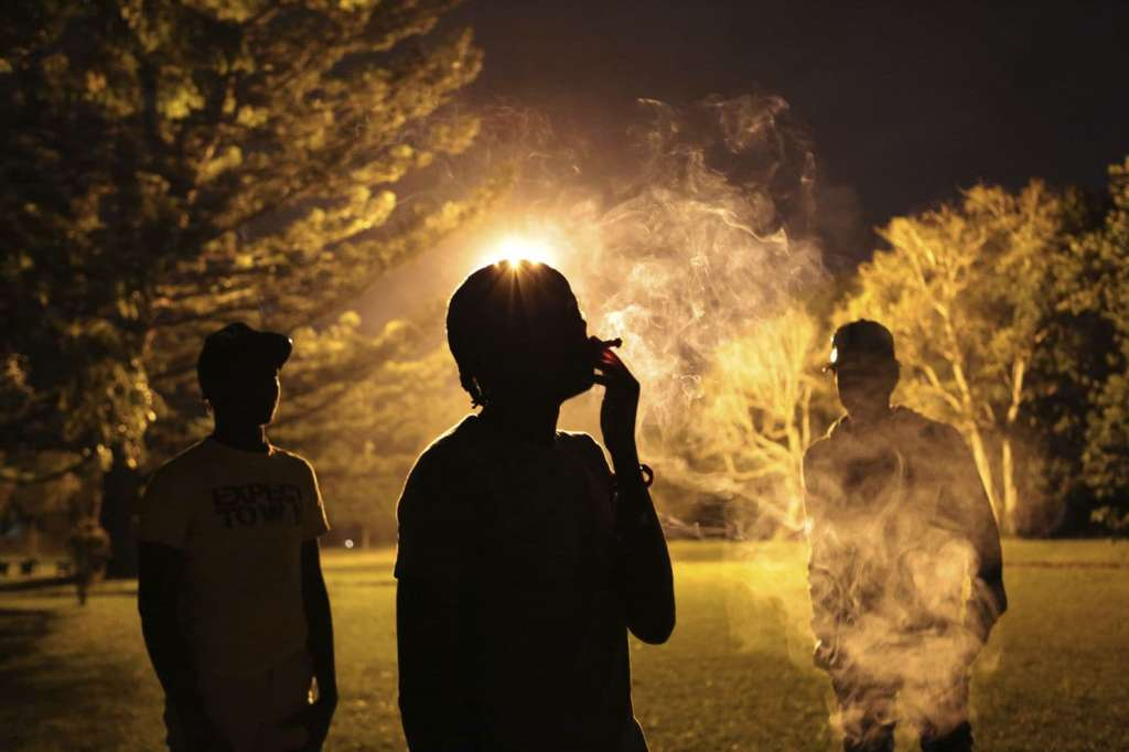 Youths take turns to smoke marijuana in a park in Harare, Friday, May, 4, 2018. The Zimbabwean government has legalised marijuana farming for medicinal and scientific purposes and becomes one of the rare African countries to do so. The country's new President Emmerson Mnangagwa is rolling out new freedoms as never seen before in the country recovering from a 37 year grip of former leader Robert Mugabe. (Tsvangirayi Mukwazhi/Associated Press)