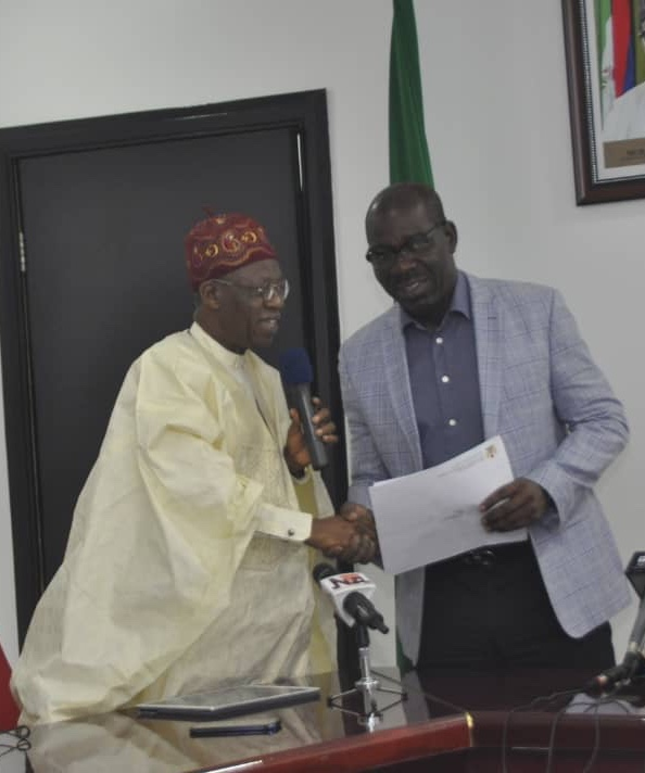 Minister of Information and Culture, Alhaji Lai Mohammed (left), handing over an Invitation Letter to the 61st United Nations World Tourism Organisation Commission for Africa Meeting to Governor Godwin Obaseki (right) at the Edo State Government House in Benin on