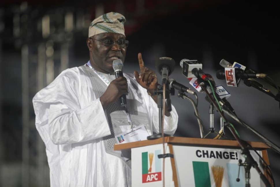 FILE PHOTO: Presidential aspirant and Nigeria's former Vice-President Atiku Abubakar speaks as he presents his manifesto at All Progressives Congress (APC) party convention in Lagos early December 11, 2014. REUTERS/Akintunde AkinleyeREUTERS