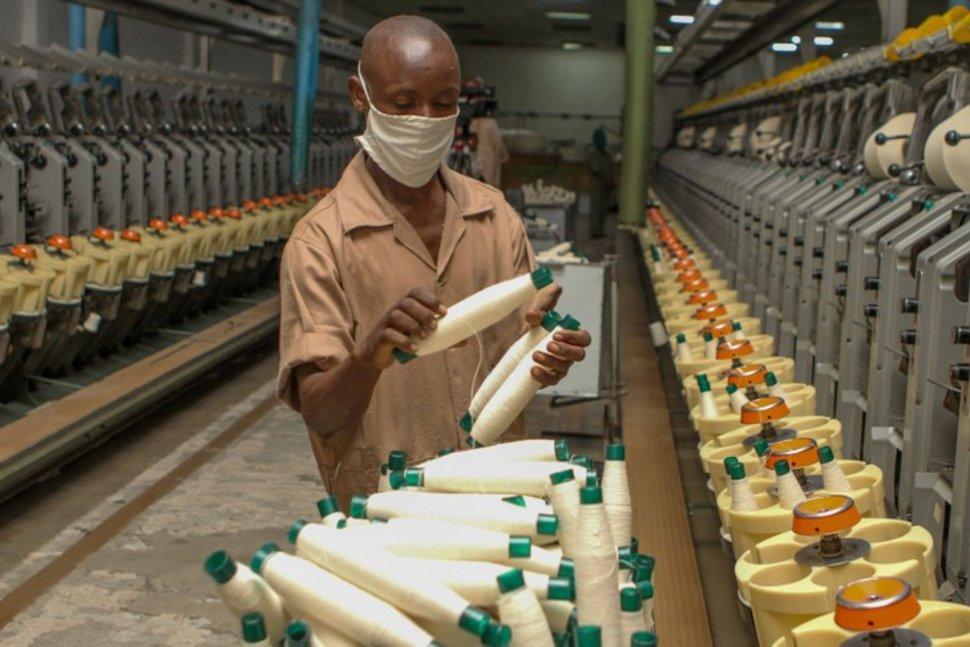 A worker prepares thread at the the Utexrwa garment factory in Kigali, Rwanda April 17, 2018. Picture taken April 17, 2018. REUTERS/Jean BizimanaREUTERS