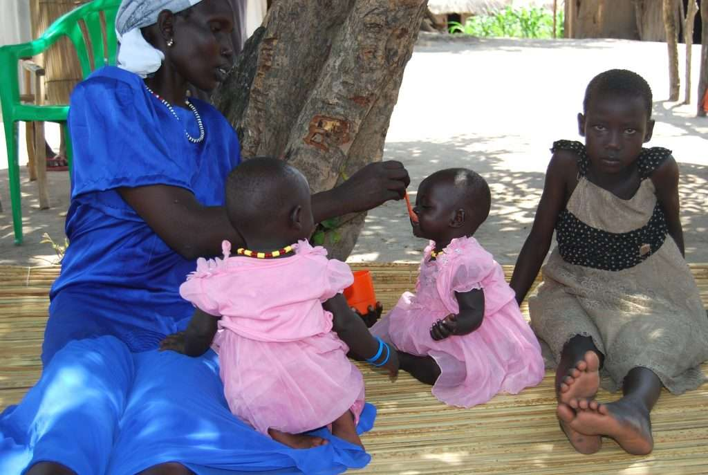 A South Sudanese mother feeds her child at Palorinya settlement camp in Moyo district. Photo by PAUL NIGHT