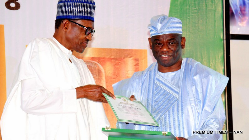 President Muhammadu Buhari presenting a Post-Humus GCFR Award to Mr Kola Abiola, son of the acclaimed winner of June 12 1993 Presidential Election, Chief MKO Abiola during a Special National Honours Investiture at the Presidential Villa in Abuja on Tuesday (12/6/18)