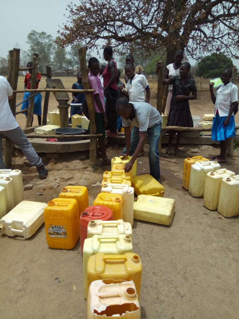 Refugees waiting to fetch water in one of the community boreholes on Imvepi camp entrance. PHOTO BY_ PAUL NIGHT