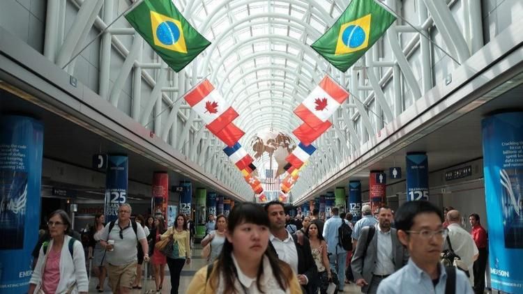 Flags are displayed at Chicago O'Hare International Airport in 2015. Direct flights to Ethiopia begin June 11, 2018. Direct New Zealand flights begin in November; officials say Chicago will join just five other cities with nonstop flights to all six major inhabited world regions. (Anthony Souffle / Chicago Tribune)