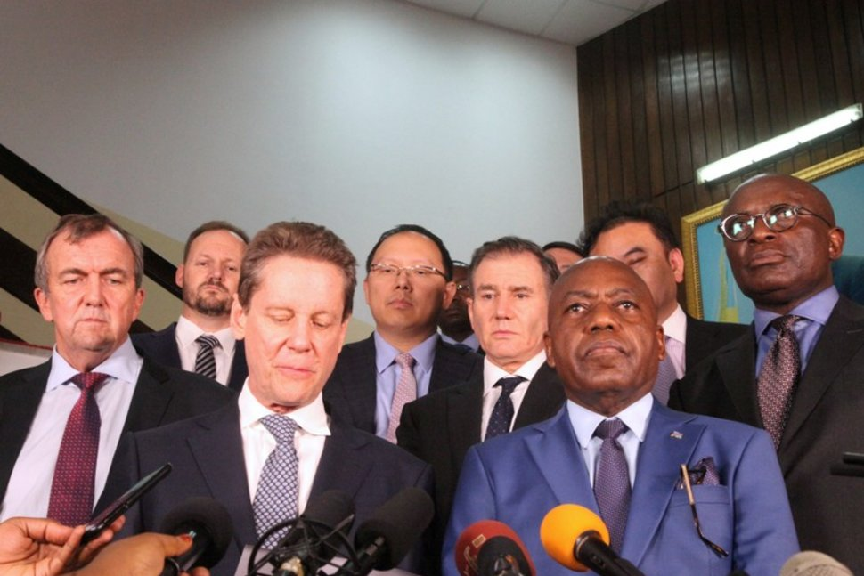 FILE PHOTO: Congo's Mines Minister Martin Kabwelulu flanked by mining executives operating in Congo addresses a news conference after a meeting President Joseph Kabila (not in the picture) in Kinshasa, Democratic Republic of Congo March 7, 2018. REUTERS/Kenny Katombe/File Photo