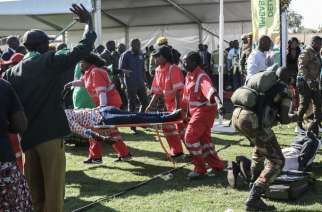 Injured people are evacuated after an explosion at the stadium in Bulawayo where Zimbabwe President addressed a rally. Photo: AFP