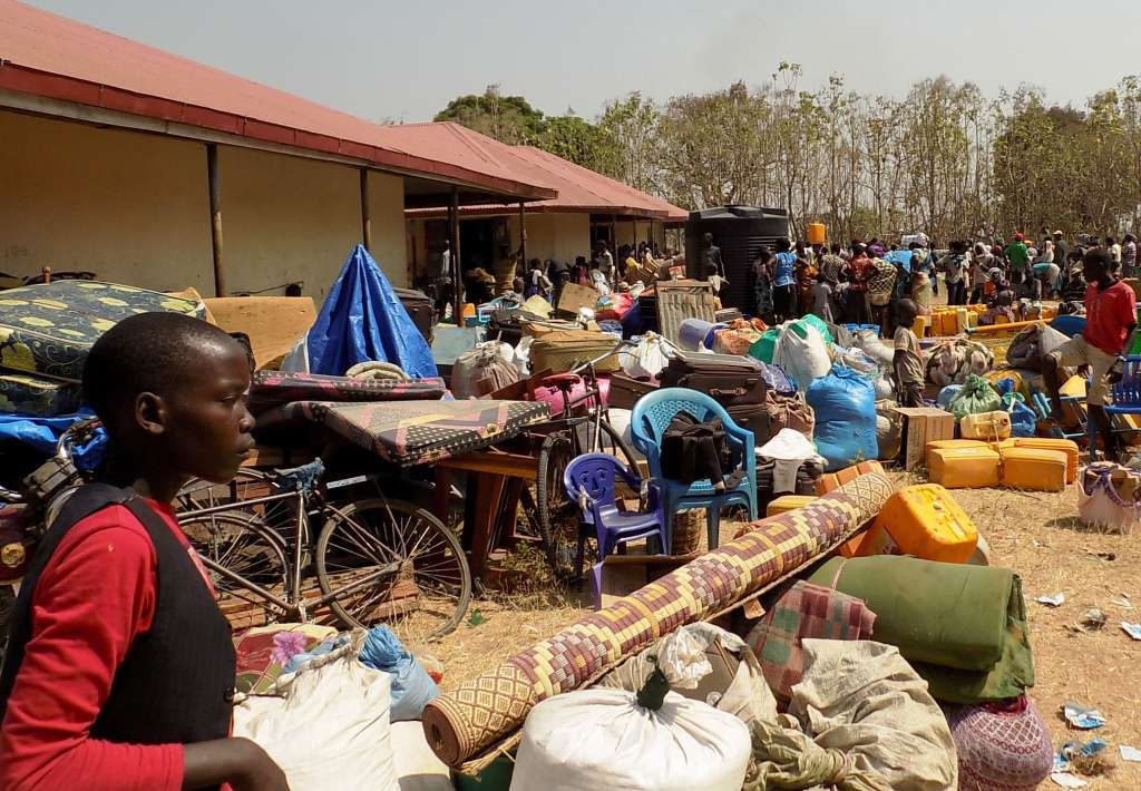 some of the South Sudanese refugee struggles for water at Afoji Market on the day of arrival in Uganda.PHOTO PAUL NIGHT