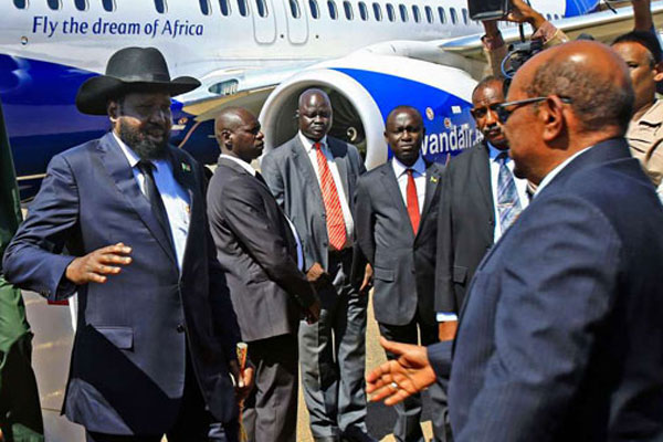 South Sudanese President Salva Kiir is welcomed by his Sudanese counterpart Omar al-Bashir on arrival at Khartoum International Airport for a two-day visit that aims at resolving pending bilateral issues on November 1, 2017. AFP PHOTO