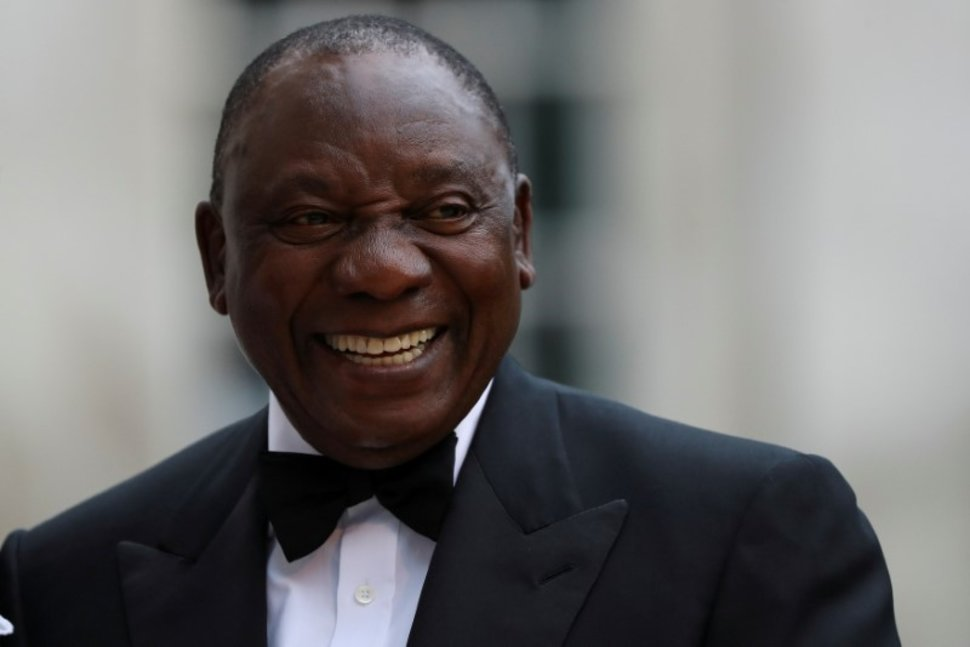 FILE PHOTO: South Africa's President Cyril Ramaphosa reacts as he arrives to attend the Commonwealth Business Forum Banquet at the Guildhall in London, Britain April 17, 2018. REUTERS/Simon Dawson/File PhotoREUTERS