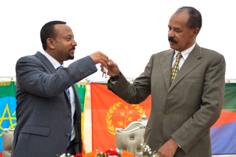 Ethiopian Prime Minister Abiy Ahmed (L) and President Isaias Afwerki of Eritrea celebrated the reopening of Asmara's embassy in Addis Ababa on Monday (AFP Photo/MICHAEL TEWELDE)